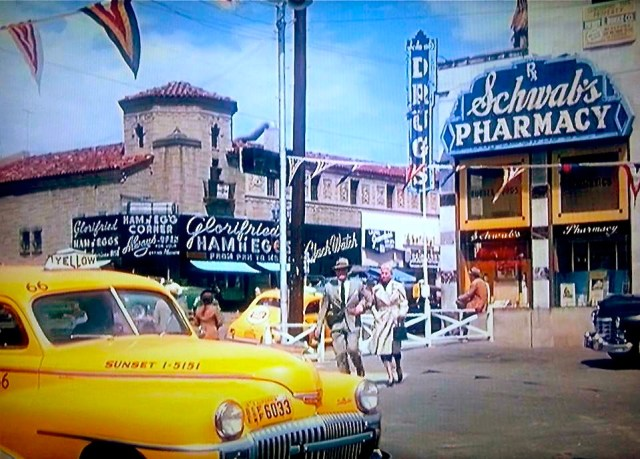"Jack Carson and Doris Day head for a cab in the parking lot of Schwab's in ""My Dream Is Yours"" (1949)."
