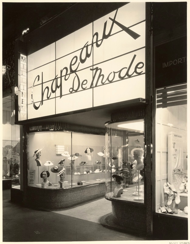 Chapeaux de Mode display window at night. 6514 Hollywood Blvd, 1920s