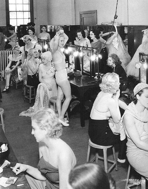 MGM Chorus girls crowd into the dressing room as they prepare for the day's shoot of the musical Dancing Lady, starring ex-chorus girl Joan Crawford, 1932
