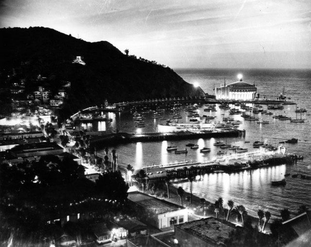 Night view of Avalon Bay, with the Casino shining brightly in the background, Catalina Island, 1957