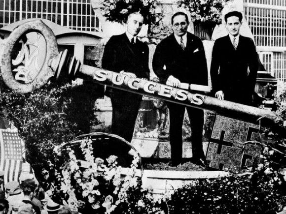 On the stand at the Hollywood studio dedication April 26th, 1924, are Louis B. Mayer, head of the new company, flanked by Harry Rapf (left) and Irving Thalberg, who shared production responsibilities