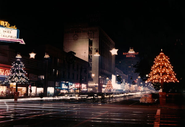 Corner of Hollywood and Vine decorated for the holidays, circa 1950