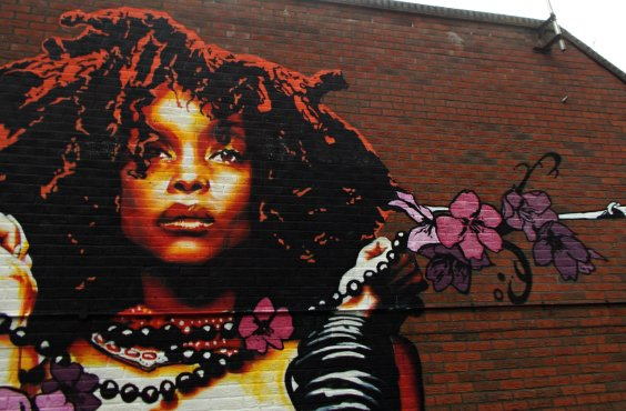 Erykah Badu, represented here by Eva Mena's street art on a London wall, is one less problematic artist for feminists who like rap music. Photo by Tony Monblat via Flickr