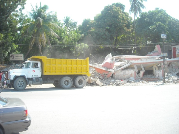 A dump truck beside a collapsed building in Port-au-Prince Haiti