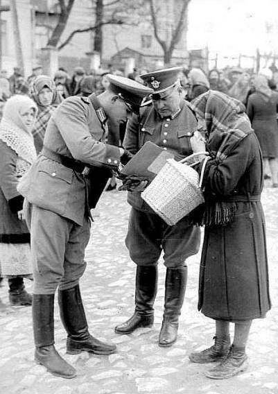 Nazis searching Jews Nazi persecution