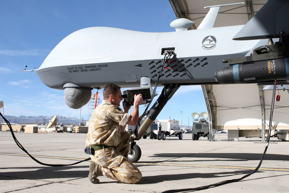 a service man works with a drone