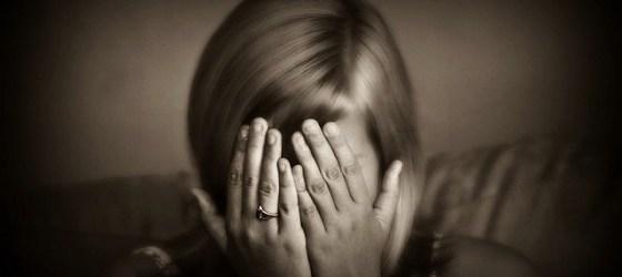 sad girl head in hands