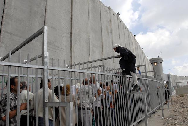 Waiting to cross the Bethlehem wall