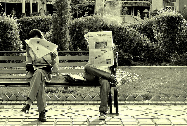 Two Iranians reading newspaper
