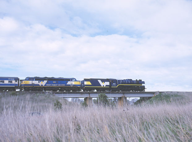 "In ""multiple unit"" on the Saturday morning service to Warrnambool, R 711 and B 76 cross the Mt Emu Creek bridge between Boorcan and Terang. 4.8.2001. MARTYN BANE"
