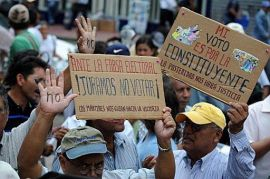 "Supporters of Zelaya raise their painted hands calling the people not to vote in the November 29 ""election"", during a demonstration in Tegucigalpa."