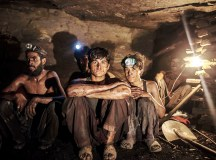 Miners pose for a photograph at the coal face inside a mine in Choa Saidan Shah, Punjab province, April 29, 2014. Workers at this mine in Choa Saidan Shah dig coal with pick axes, break it up and load it onto donkeys to be transported to the surface. Employed by private contractors, a team of four workers can dig about a ton of coal a day, for which they earn around $10 to be split between them. The coalmine is in the heart of Punjab, Pakistan's most populous and richest province, but the labourers mostly come from the poorer neighbouring region of Khyber Pakhtunkhwa. Picture taken April 29, 2014. REUTERS/Sara Farid (PAKISTAN - Tags: BUSINESS SOCIETY ENERGY TPX IMAGES OF THE DAY)  ATTENTION EDITORS: PICTURE 08 OF 24 FOR PACKAGE 'COAL MINING IN THE PUNJAB'  TO FIND ALL IMAGES SEARCH 'FARID COAL'