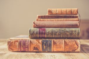 short fiction versus long: stack of vintage books