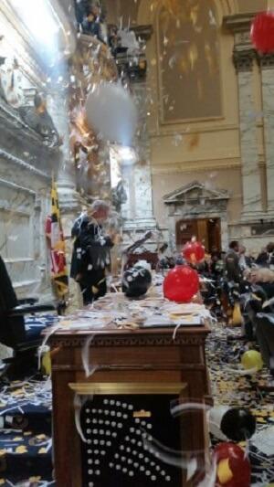 Confetti falls on House Speaker Michael Busch