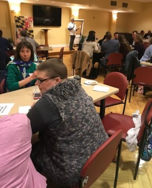 Team members confer during the Maryland Matters Trivia Night. Photo by Rylinn Sorini