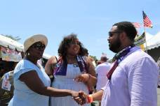 Del. Wanika Fisher (D-Prince George's), center, introduces Del. Nick Charles (D-Prince George's) to her best friend's mother, Lawanda Dockins-Mills, at the Tawes Crab and Clam Feast.