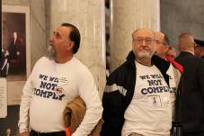 Second Amendment advocates stand outside the House of Delegates chamber before the annual State of the State address in Annapolis. Photo by Danielle E. Gaines.
