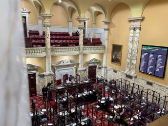 Senate President Bill Ferguson (D-Baltimore City) presides over a Senate chamber that was outfitted with plexiglass dividers to protect against the spread of COVID-19. Photo by Danielle E. Gaines.
