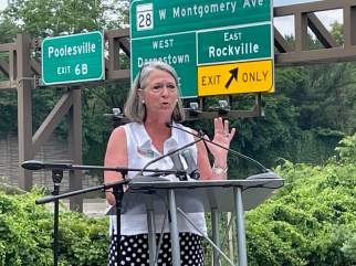 Addressing a rally of transit activists and environmentalists, Rockville Mayor Bridget Donnell Newton said local officials still have unanswered questions about a plan to widen I-270 and portions of the Capital Beltway. Photo by Bruce DePuyt.