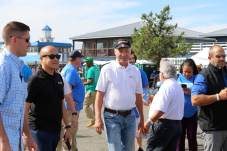 Comptroller Peter V.R. Franchot (D) is surrounded by staff and campaign workers as he toured the Somers Cove Marina during the 2021 J. Millard Tawes Clam Bake and Crab Feast. Photo by Danielle E. Gaines.