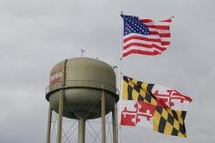 Flags flew high above the political goings-on at the 2021 J. Millard Tawes Clam Bake and Crab Feast in Crisfield. Photo by Danielle E. Gaines.