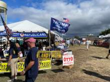 A Trump 2024 flag flew over a row of campaign tents sponsored by Republican lawmakers and candidates at the J. Millard Tawes Clam Bake and Crab Feast. Photo by Bruce DePuyt.
