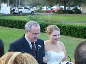 Becca being escorted down the aisle by her dad, Ben
