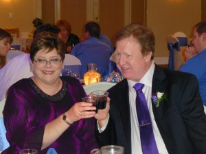 Phyllis and Gary toast the happy couple