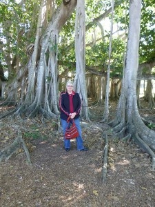 Mary standing by the enormous banyan tree