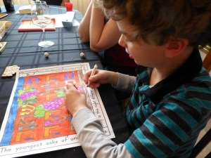 Nathan works on coloring his placemat