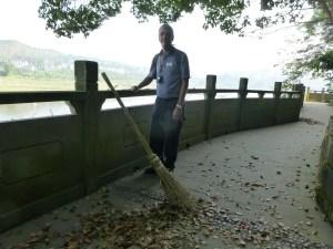 A handmade broom on the pagoda grounds and John