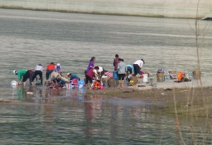 People washing their clothes in the river