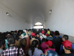 Crowds and us surging through a tunnel to the Forbidden City