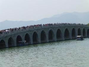 A bridge full of Chinese tourist cross the lake