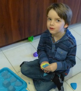 Sam playing with his kinetic sand from Aunt Peg and Uncle Ted