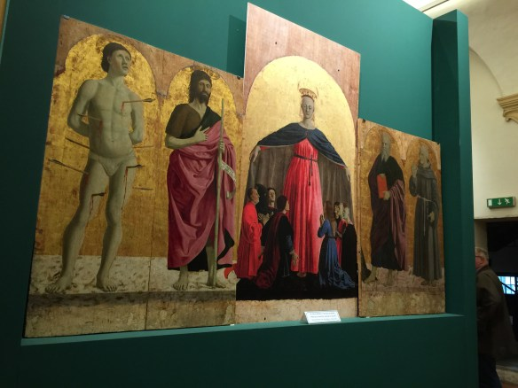 We see the side panels to the Madonna Miseriecordia triptych - the original center panel of the Madonna is in Forli