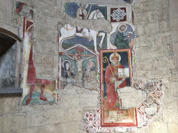 This cathedral is so old that there are layers of frescoes