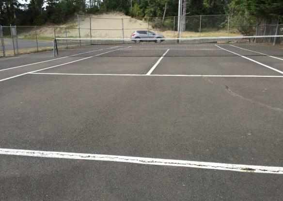 Derelict tennis court