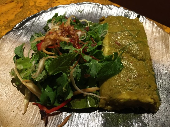Surgeon with green curry sauce steamed in a banana leaf and served with a cilantro and mint salad