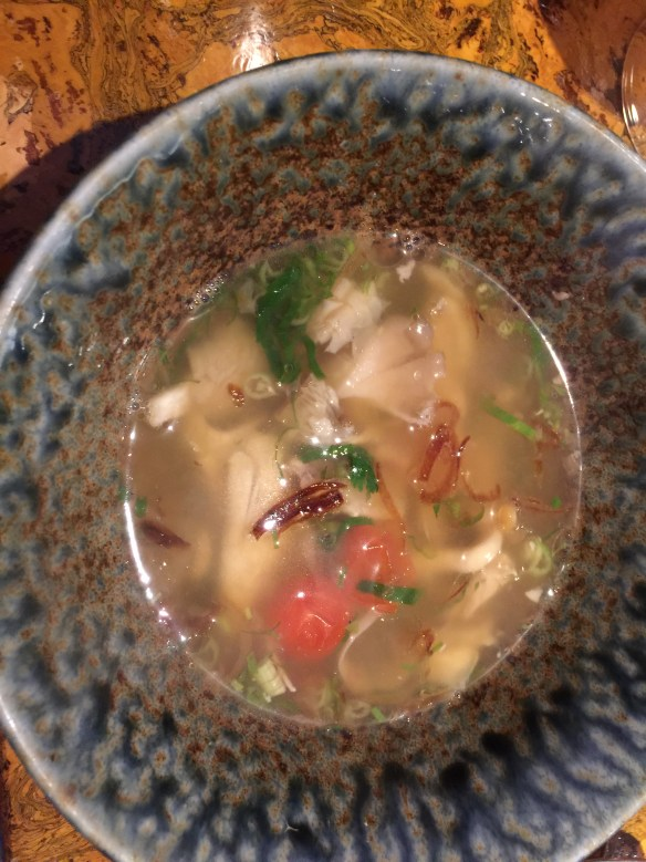 Hot and sour chicken soup with oyster mushrooms
