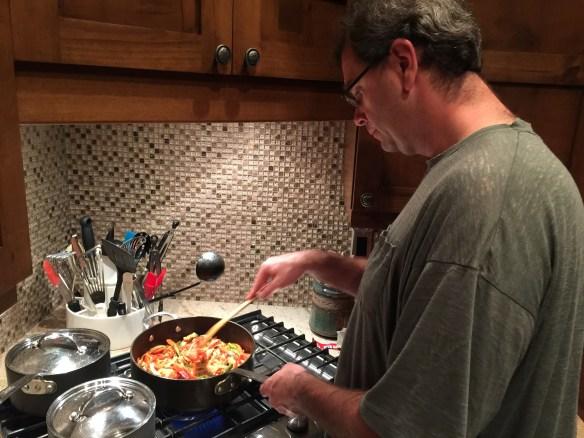 Jon cooking vegetables for fajitas