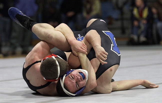 North Andover's Cooper McLeod wrestles Methuen's Rafael Caceres during their match in Methuen.