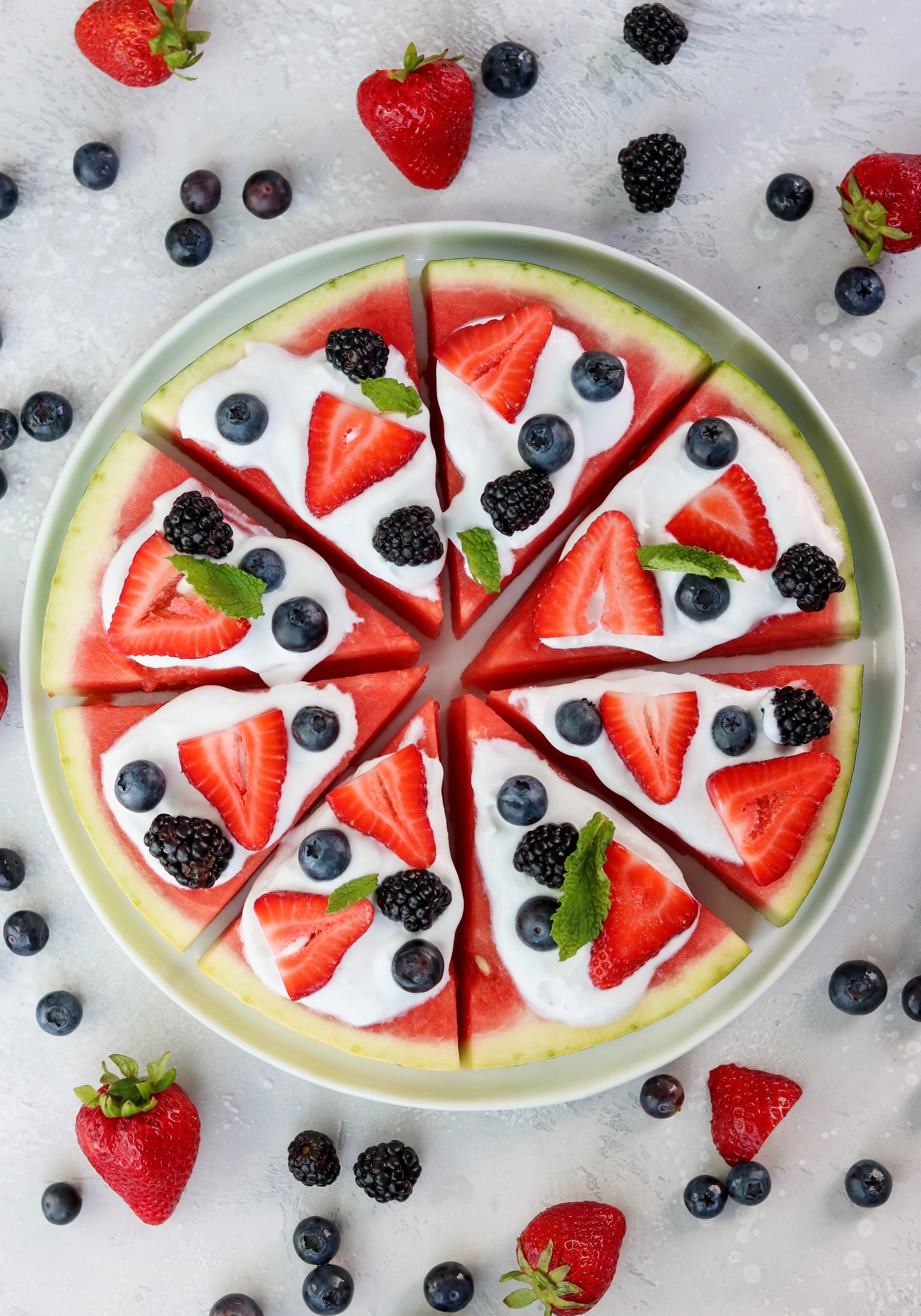 watermelon pizza with homemade coconut whipped cream and fresh berries