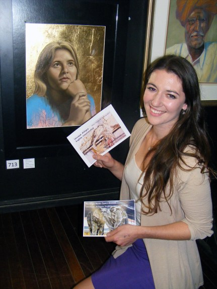 "Vanessa Allegra is pictured with her artwork ""Melissa"", highly commended in Human Form/Portraitures. She also received a highly-commended certificate in the Open category with ""Bleached""."