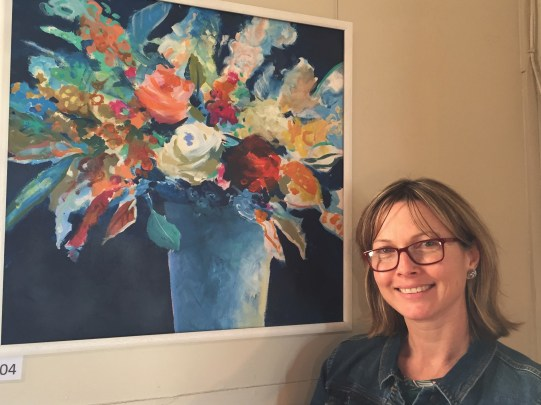 "Sherrie Rowan with the popular artwork ""A Mixed Bunch"", winner of the Still Life category and the Railway Hotel Award."