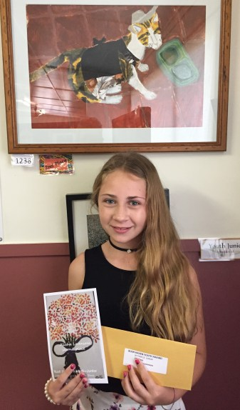"Alisha Lorenson is pictured with her winning painting ""Leo"", which collected second prize in the Bush Haven Youth Art Awards junior section."