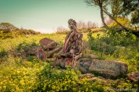 Sculpture of man sitting at Albany Bulb