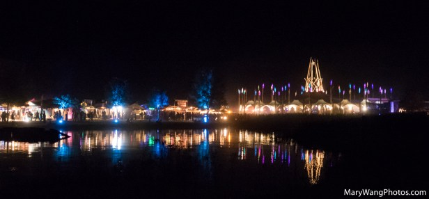 Lake reflections at night of The Hub and vendors