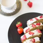 Glutenfree banana cake with strawberry chips and white chocolate