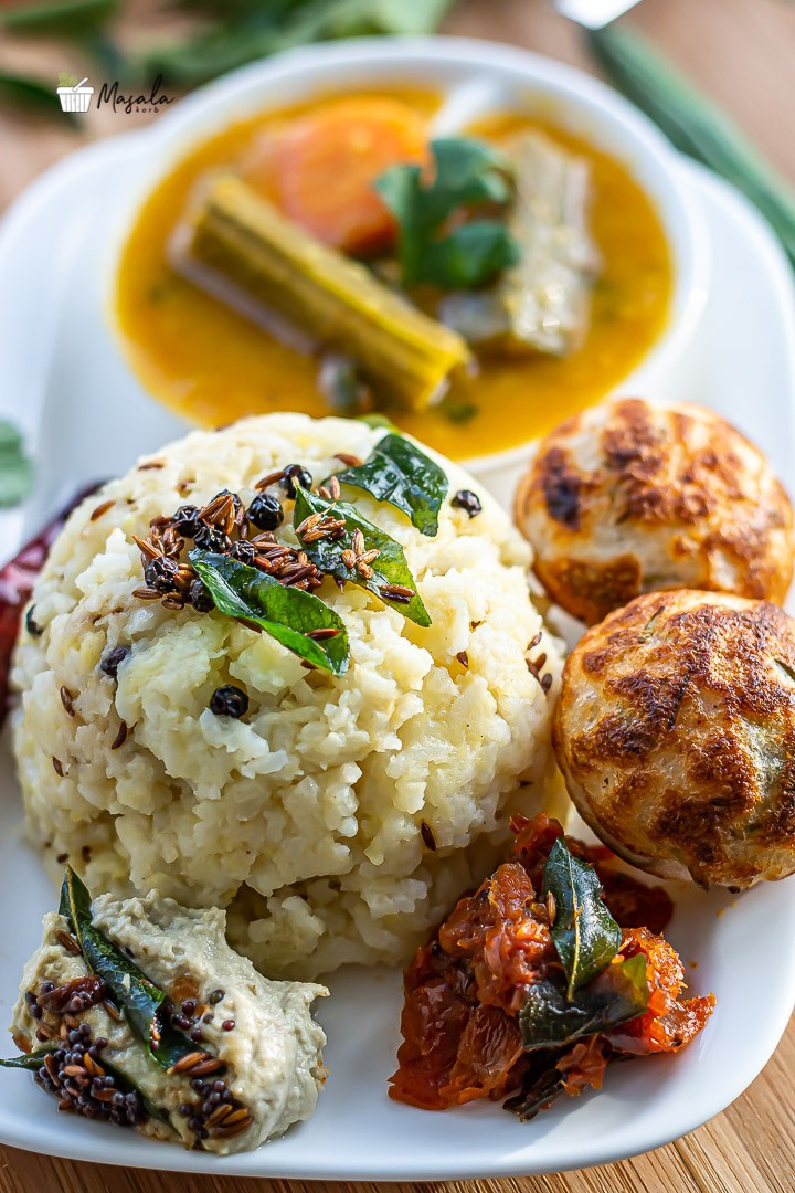 Pongal served with sambar, chutney and Paniyaram